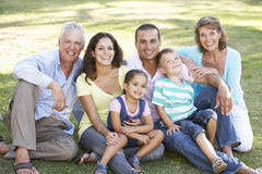 Three Generation Family Relaxing In Summer Park Royalty Free Stock Photos