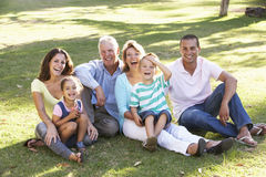 Three Generation Family Relaxing In Summer Park Stock Photo