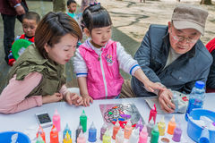 Three generation family sketching leisure in fuxing park shangha Royalty Free Stock Photos