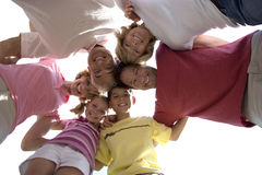 Three generation family standing in huddle, smiling, portrait, upward view, cut out Stock Image