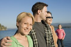 Three-generation family standing on lake Stock Photography