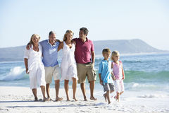 Three Generation Family Walking Along Beach Royalty Free Stock Photography