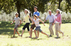 Three Generation Family Walking In Countryside Stock Images
