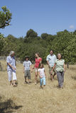 Three Generation Family Walking In Field Stock Image