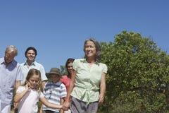 Three Generation Family Walking Outdoors. Happy three generation family walking against clear blue sky Stock Photography