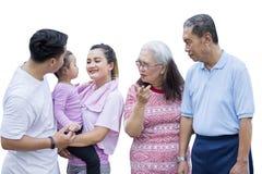 Three generation family wears sportswear on studio royalty free stock photography