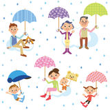 Three-generation family who puts up the umbrella. The three-generation family who puts up the umbrella happily because of rain stock illustration