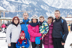 Three generation group portrait of family skiing in the mountain Stock Image