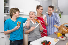Three generation living together: happy family in the kitchen. Royalty Free Stock Images