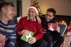 Three generation of men. Men of three generations sitting on the sofa Royalty Free Stock Photo