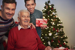 Three generation of men. Grandfather, son and grandson on one photography Stock Photos