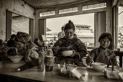 Three generation of a minority tribe having meal at Sapa Vietnam Stock Photos