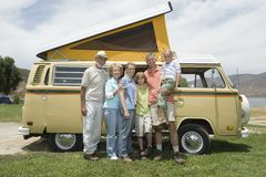 Three Generational Family With Campervan. Full length portrait of happy three generational family with campervan Royalty Free Stock Photography