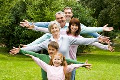 Three generations. Portrait of senior and young couples with their children having fun outdoors Royalty Free Stock Photo