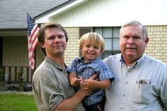 Three generations. Portrait of three generations of men outside of a home Stock Photo