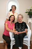 Three Generations. Of women pose and smile for the camera Royalty Free Stock Photos