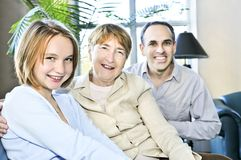 Three generations. Happy family of three generations sitting together Royalty Free Stock Photography