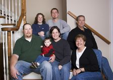 Three generations family. Family in casual photo on stairs Royalty Free Stock Photos