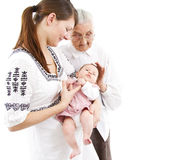 Three generations. Of a family: baby, mother and great-grandmother Royalty Free Stock Image