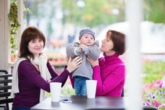 Three generations family in a cafe Royalty Free Stock Photography