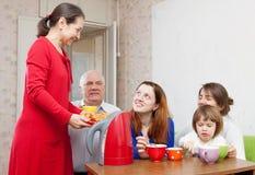 Three generations family drinks tea Royalty Free Stock Photography