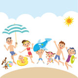 Three generations of a family playing in the beach Royalty Free Stock Image