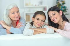 Three generations family resting on couch Stock Photography
