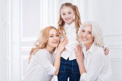 Three generations of the family resting together at home Stock Image