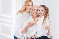 Three generations of the family resting together Royalty Free Stock Image