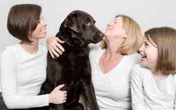 Three Generations of a Family with their Dog Stock Image