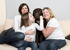 Three Generations of a Family with their Dog Royalty Free Stock Image
