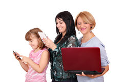 Three generations girls with phone tablet and laptop Stock Photography