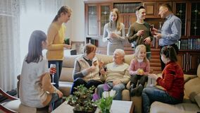 Three generations of happy family carefree communicating in comfortable apartment