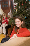 Three generations - happy mother at Christmas stock photos