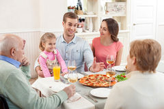 Three generations have dinner together Royalty Free Stock Photo