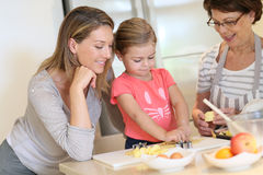 Three generations having fun cooking together Royalty Free Stock Photography