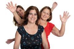 Three generations of hispanic women on a white background stock photography
