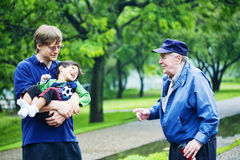 Three generations interacting. Together at park Royalty Free Stock Images