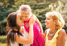 Three generations - intimate moments Royalty Free Stock Photos