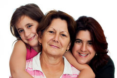 Three generations of latin women isolated on white stock images