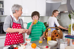 Three generations living together - happy family cooking together. stock image