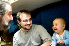 Three generations of men in train Stock Image