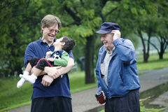 Three generations at park. Three generations interacting together at park Stock Photography