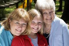 Three Generations in Park. Three generations, a grandmother, mother, and daughter in the park