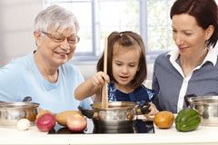 Three generations playing cooking Royalty Free Stock Photography