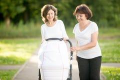 Three generations walking in park Royalty Free Stock Photo
