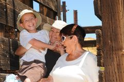 Three generations Western Corral Royalty Free Stock Image
