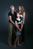 Three generations of women. Three generations of attractive women Royalty Free Stock Photo