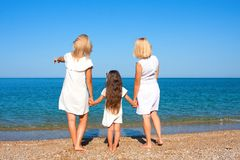 Three generations of women on the beach Royalty Free Stock Photos