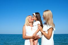 Three generations of women on the beach Royalty Free Stock Images